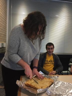 Melanie cutting the Kings' Cake