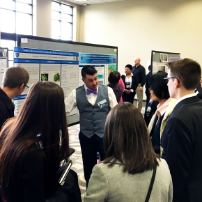 Taylor at the poster session at the Midwest Graduate Research Symposium - April 7, 2016